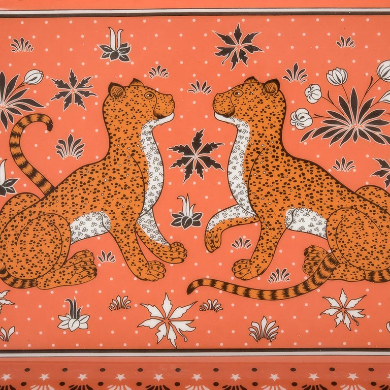 Guaranteed authentic Hermes Limoges Porcelain Leopards change tray. Depicts 2 Leopards sitting playfully across each other in Sienna. A perfect accent piece for any room. Protected by suede on the base. Wonderful for desk or gifting. Accompanied