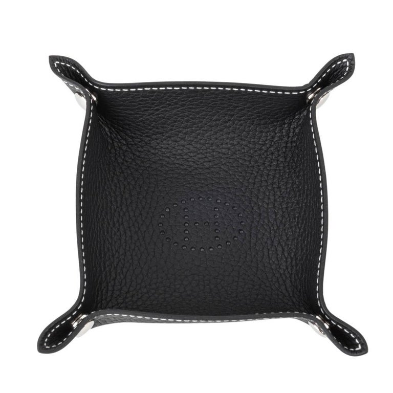 Guaranteed authentic Hermes Mises et Relances mini change tray. Beautifully crafted in Black Clemence leather. Palladium clou de selle snaps. A beautiful desk or bedroom accessory. Stamped Hermes Made in Italy. New or Store Fresh Condition final