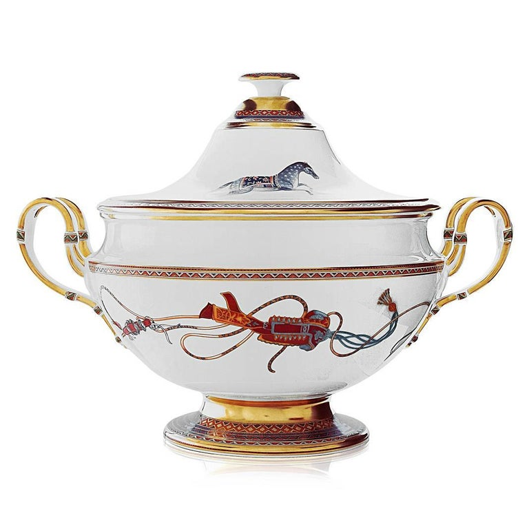 This magnificent Hermes Cheval d'Orient soup tureen has a pattern based on the intricacy and refinement of Persian miniatures, resplendent in colors and equestrian motifs richly evocative of Silk Road caravans. Made in Limoges, France. Cheval