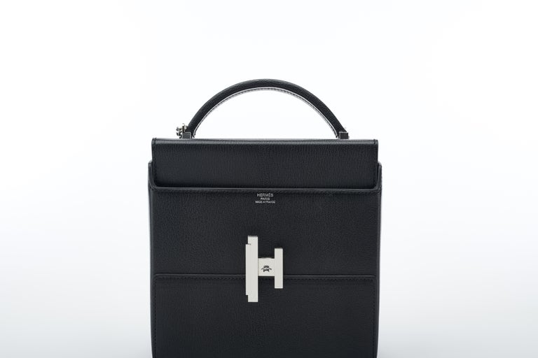 The newest model in the Hermès line, the Cinhetic has been all but impossible to find in stores. A slim, structural bag the Cinhetic lends itself perfectly to either casual day use or dressed up for evening.    The bag featured here is made in light
