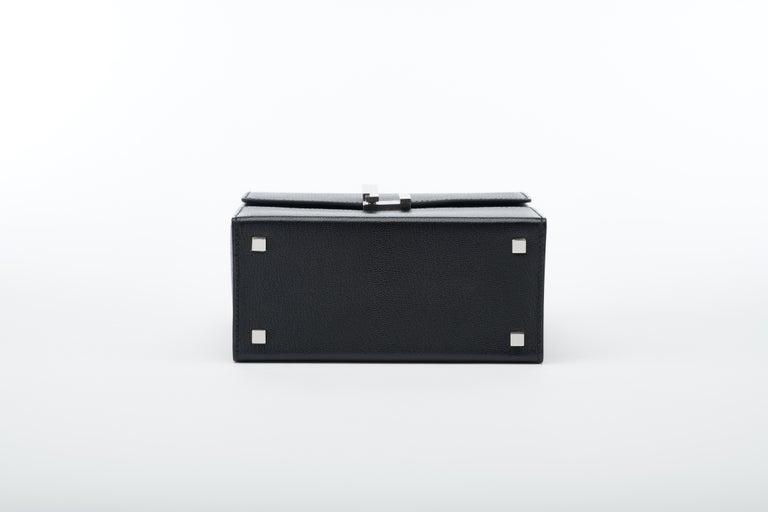 Women's or Men's Hermès Cinhetic in Black Chevre Leather with Palladium hardware.  For Sale