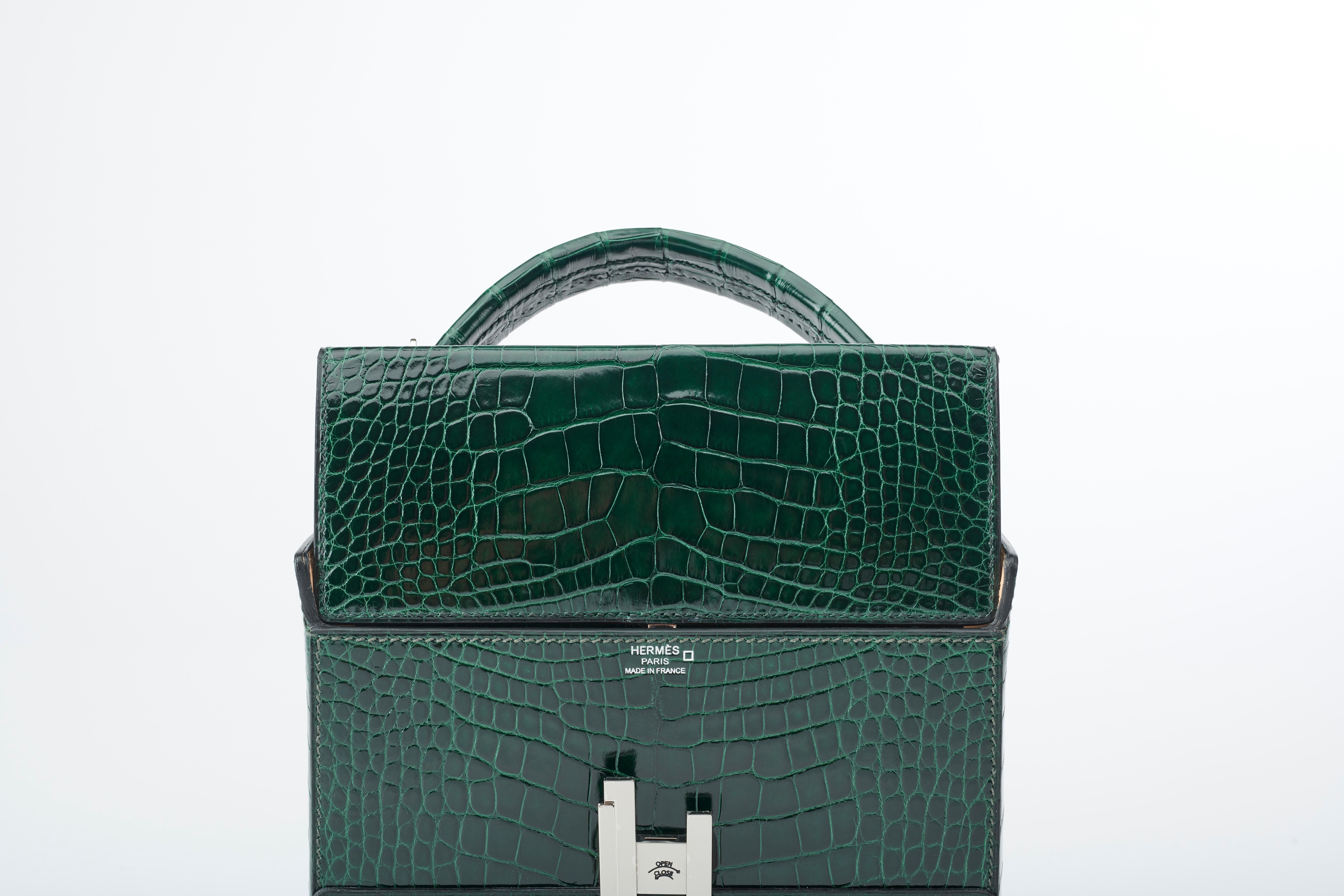 0e521e77ee Hermès Cinhetic in Vert Fonce Verso Alligator Leather with Palladium  hardware. For Sale at 1stdibs