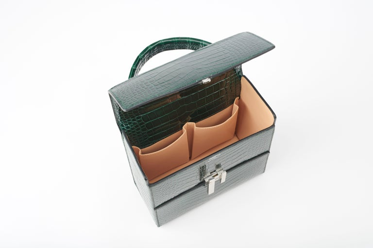 1d25a10b00 Women's or Men's Hermès Cinhetic in Vert Fonce Verso Alligator Leather with  Palladium hardware. For