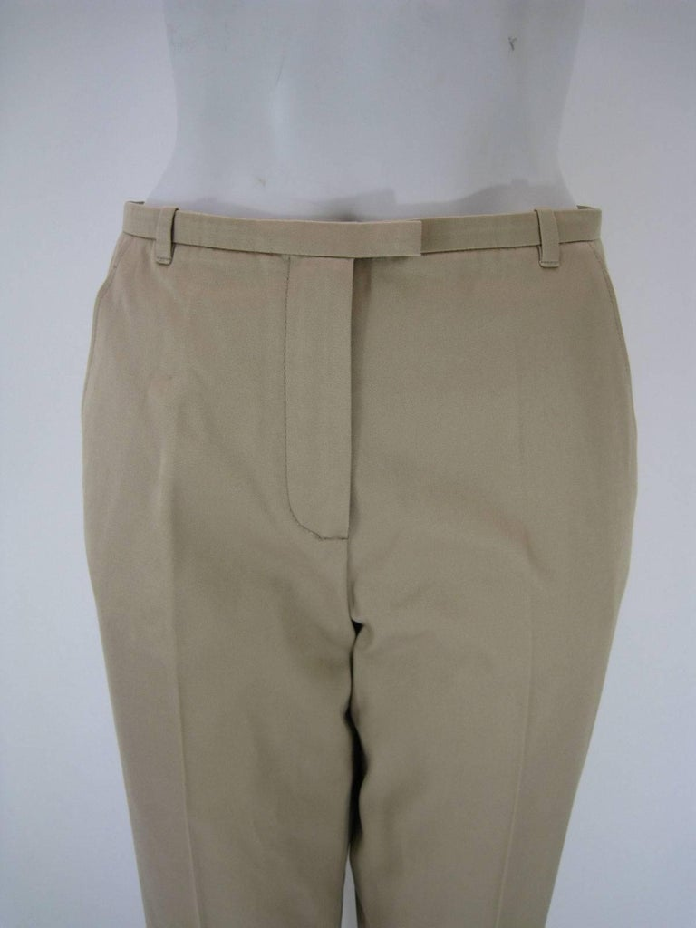 Classic Hermes khaki slacks.  Light tan color.  Straight legged.  Flat front.  Front zipper, button and hook closure.  Side pockets and one back pocket.  Belt hoops.  Tagged size 38.  Made in Italy.  This item is in good pre-owned condition. No rips