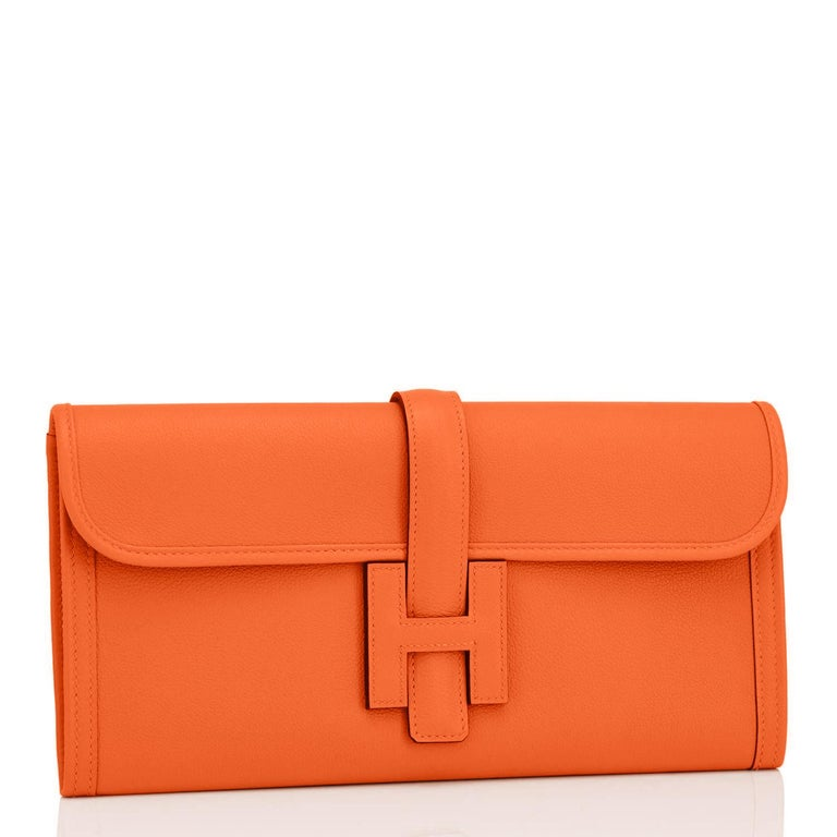 Hermes Classic Orange Jige Elan Clutch Bag 29cm NEW RARE Perfect Gift!  New or Never Worn. Pristine condition.   Comes in full set with Hermes dust bag, Hermes ribbon, and Hermes box. Classic Hermes Orange is perhaps the most loved color in Hermes