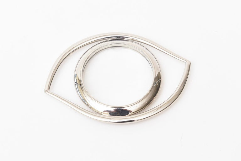 This ever so chic Hermès vintage silver plated Cleopatra eye magnifier is a great desk accessory. This is from the 1960s and was originally designed by Jean Cocteau for Hermès. It has occult and has Egyptian historical meaning. This one is marked