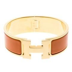 Hermes Clic Clac H Gold Plated Orange Enamel Bracelet