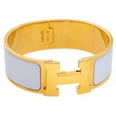 Hermès Clic Clac H White Enamel Gold Plated Wide Bracelet PM