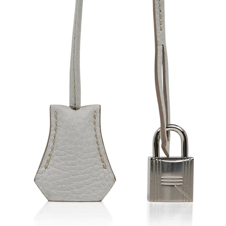 Guaranteed authentic Hermes Birkin 35 Gris Perle Club limited edition bag.  Exquisite Gris Perle and white Clemence leather accentuated with rich blue Mykonos Lizard. Palladium Hardware. Plastic on lock only. Body, corners and handles are mint. Some