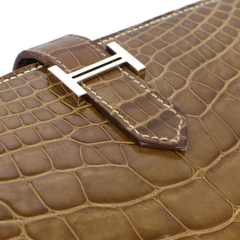 Hermes Cognac Chocolate Crocodile Exotic Leather Palladium Evening Clutch Wallet Bag in Box  Alligator  Palladium hardware Fold in buckle closure Leather lining Date code present Made in France Features zip closure, bill compartment and card slots