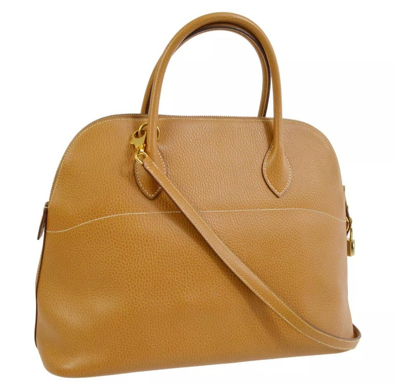 Leather  Gold tone hardware Leather lining Zip closure  Made in France Handle drop 3