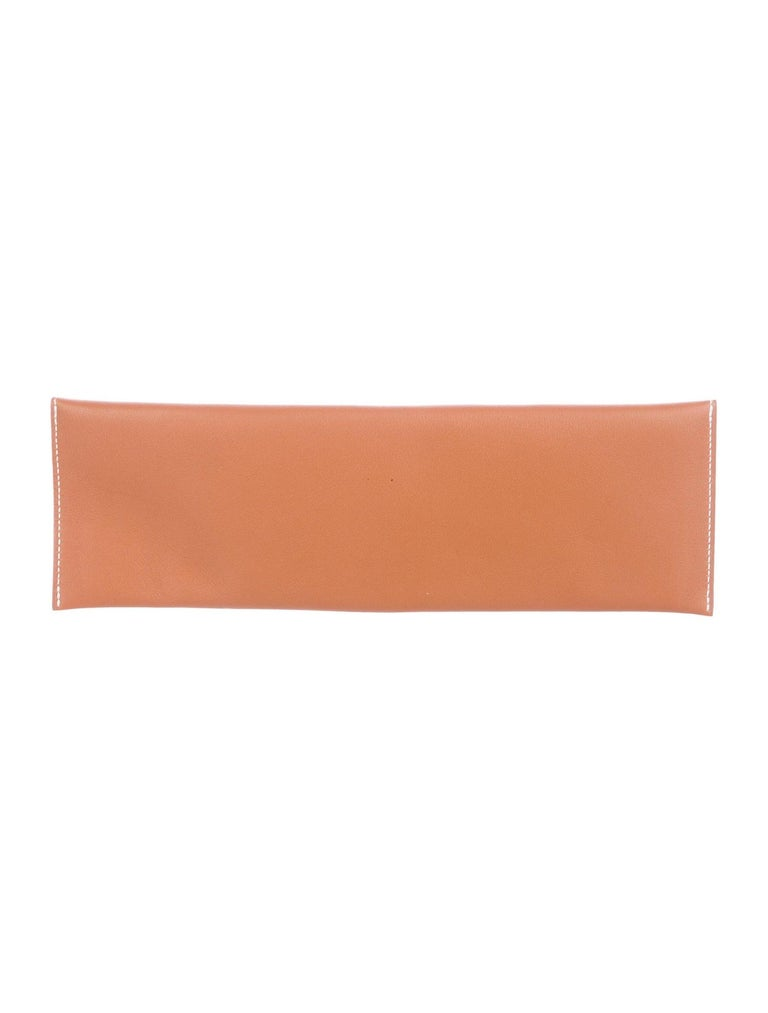 Hermes Cognac Leather Palladium Long Thin Evening Flap Clutch Bag  Leather Palladium-plated hardware Leather lining  Pull-through closure  Date code present Made in France Measures 10