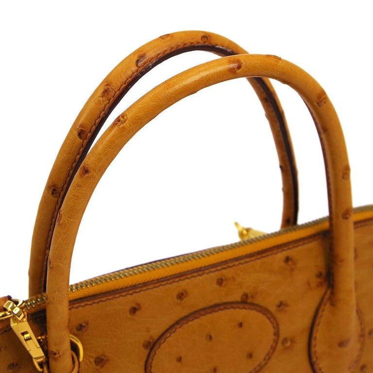Hermes Cognac Ostrich Leather Travel Bolide Gold Top Handle Satchel Shoulder Tote Bag  Ostrich leather Gold tone hardware Zipper closure Leather lining Date code present Made in France Handle drop 4