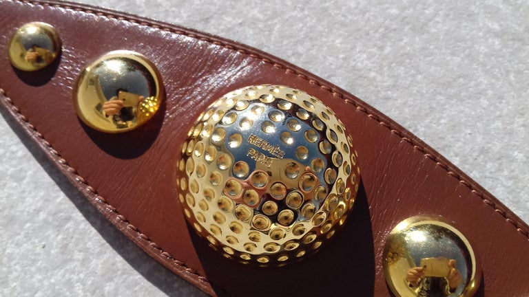 Rare Authentic Hermès Vintage Ornament  Composed of a piece of leather decorated with half balls. The middle one is printed