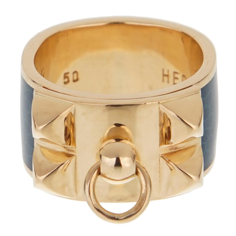 A fabulous Hermes ring from the iconic Collier De Chien collection. Crafted in 18k yellow gold, this stylish wide band (.43