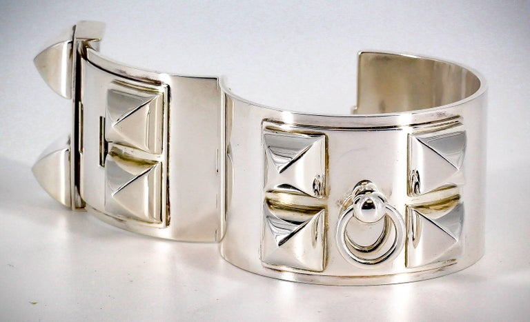 Bold sterling silver studded cuff bracelet from the Collier de Chien collections by Hermes. It features a smooth finish with large studs and easy closure. This is the large version they offer.  Hallmarks: Hermes, AG925, Made in Germany, A * G, LG.