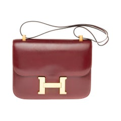 Hermes Constance 23 shoulder bag in burgundy calfskin with gold hardware !