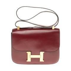 Hermes Constance 23 shoulder bag in burgundy calfskin with gold hardware !