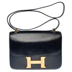 Hermes Constance 23 shoulder bag in navy blue calfskin with gold hardware !