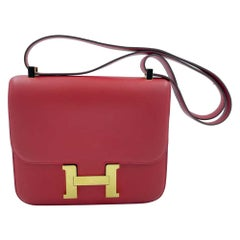 HERMES Constance Bag in Rouge Casaque Swift Leather