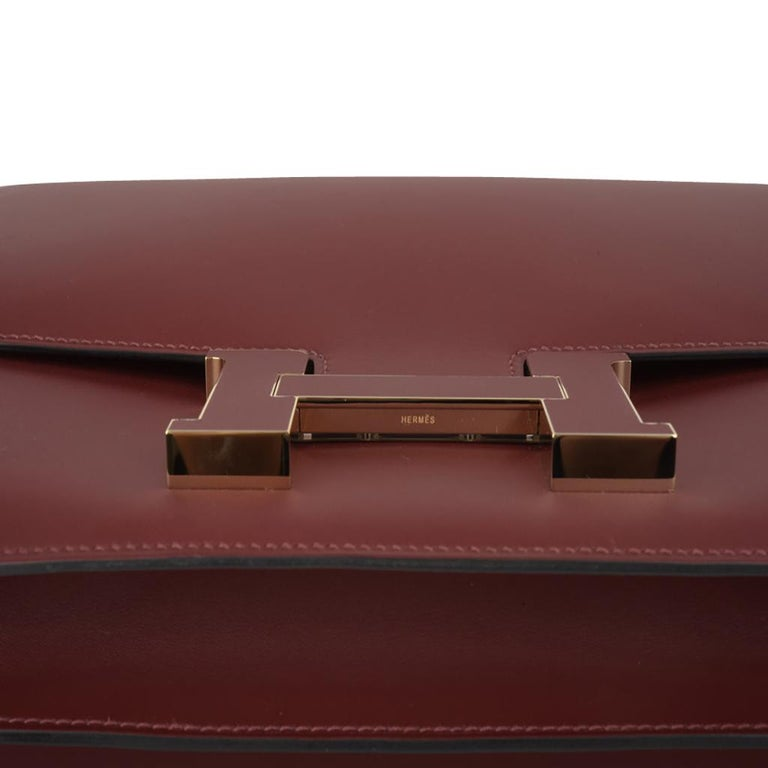 Guaranteed authentic Limited Edition Hermes Constance Cartable 29 features deep rich Rouge H Sombrero leather. Stunning inlaid leather logo clasp and shorter strap.  Carried by hand as a satchel, or over the shoulder. Hermes Paris Made in France is