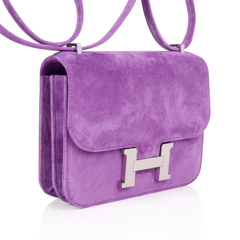 Guaranteed authentic exquisite limited edition Hermes coveted Doblis (suede) bag features the Constance Mini in Violet Clair. Beautiful muted purple that is neutral and perfect for year round wear. This is a highly collectible Hermes bag. Fresh with