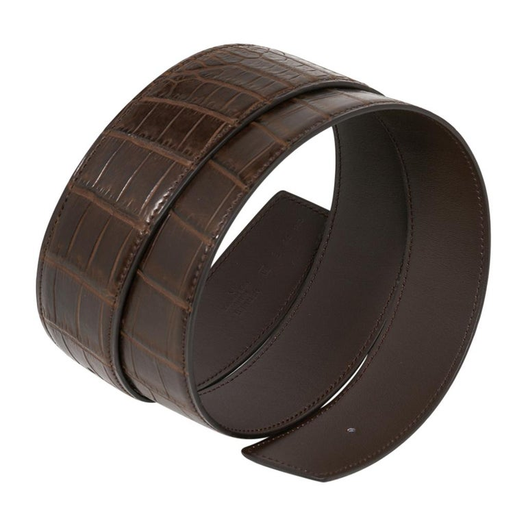 Guaranteed authentic Hermes Constance 42 mm belt features reversible Vert Titan Matte Porosus Crocodile to Brown leather.   Fabulous over sized brushed gold signature H buckle.   Now a retired size, this is sure to become a collectors treasure.