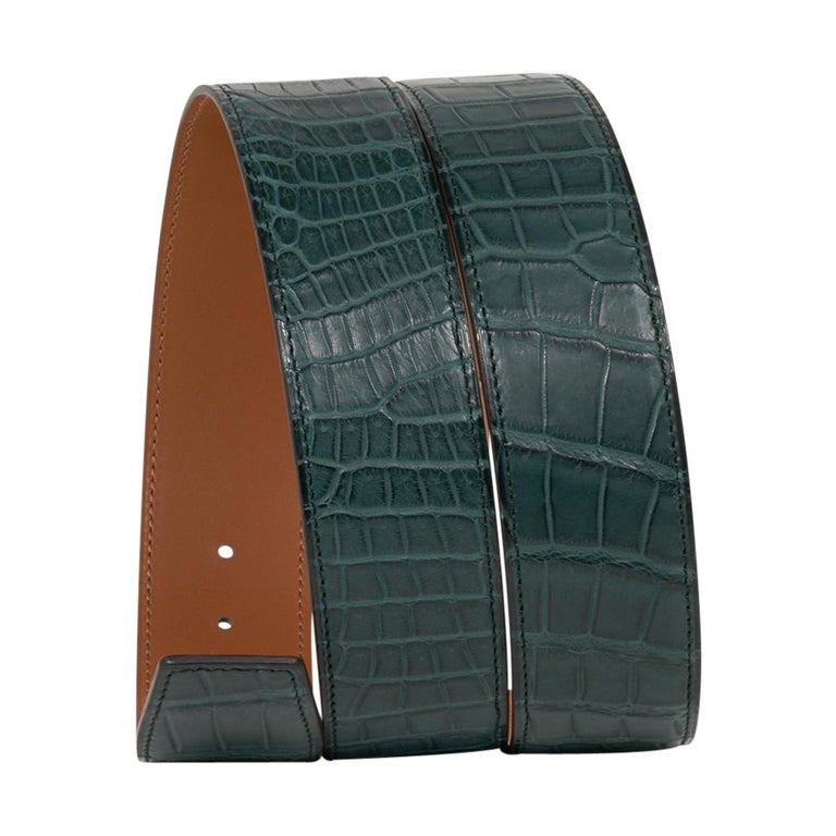 Guaranteed authentic Hermes Constance 42 mm belt features reversible Vert Titan Matte Porosus Crocodile to Gold Leather.   Fabulous over sized brushed gold signature H buckle.   Now a retired size, this is sure to become a collectors treasure.