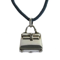 HERMES Cord necklace and 'Kelly Bag' Amulet Pendant in Sterling Silver