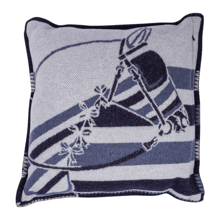 Mightychic offers a guaranteed authentic Hermes Limited Edition Couvertures Nouvelles pillow Blue Marine and Ecru. Beautiful horse face with bows set with each side in inverted colours. The removable cover is created from 85% Merino Wool and 15%