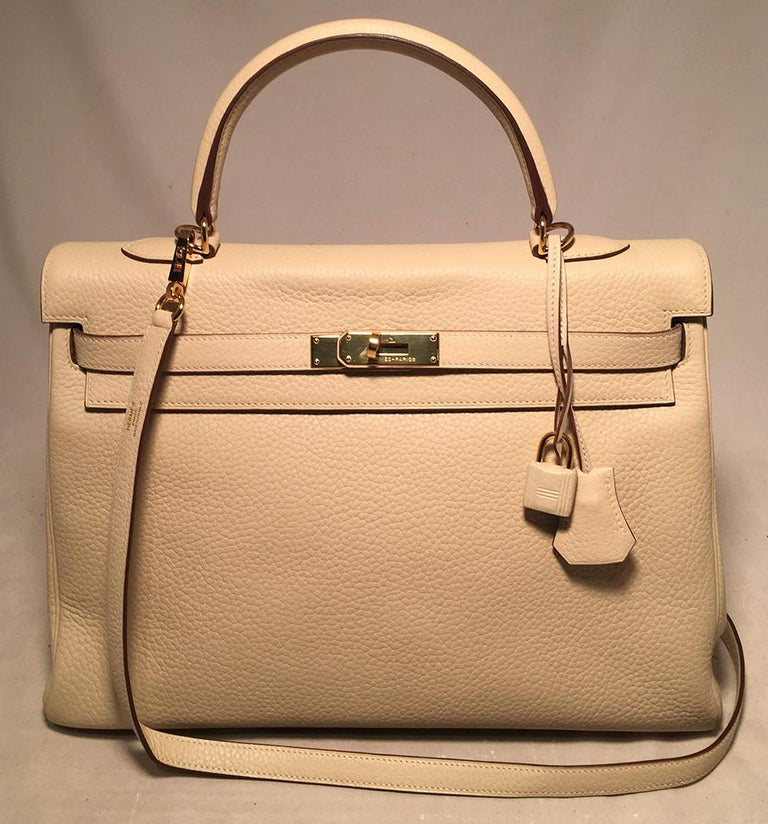 Hermes Parchemin Taurillon Clemence Leather Kelly 35 in excellent condition. Cream Parchemin beige clemence leather exterior trimmed with gold hardware. Signature front double strap turn lock closure opens to a matching cream leather interior that