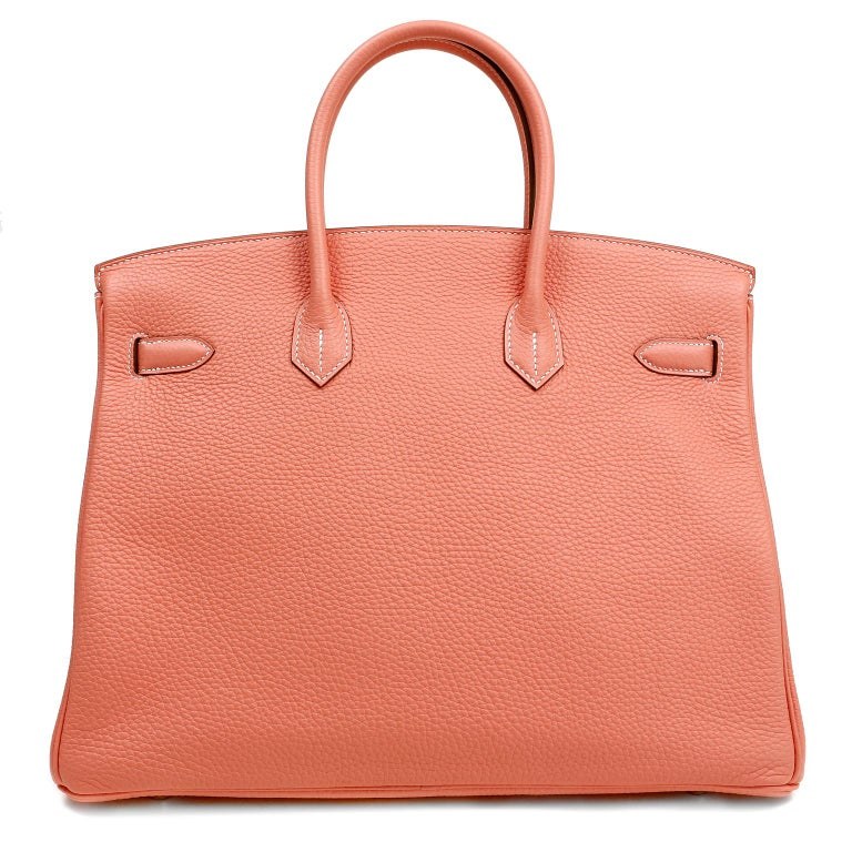 This authentic Hermès Crevette Togo 35 cm Birkin is in pristine unworn condition; the protective plastic is still intact on the hardware.  Hermès bags are considered the ultimate luxury item the world over.  Hand stitched by skilled craftsmen, wait