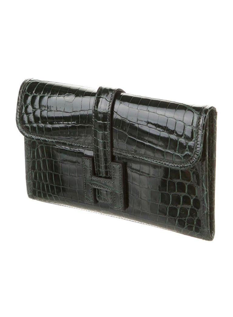 """Crocodile Leather Buckle closure Date code present Made in France  Measures 7.75"""" W x 5"""
