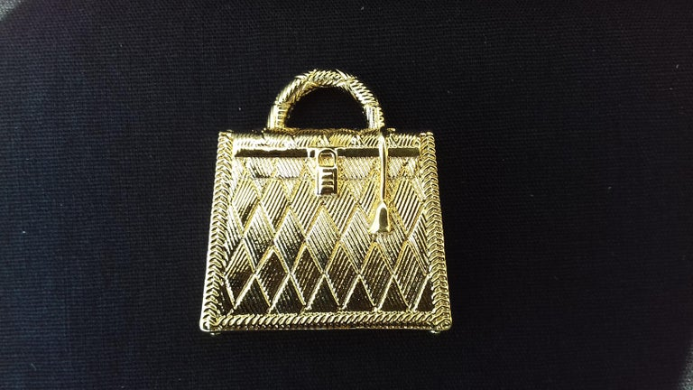 Beige Hermès Curiosity Kelly Bag Pendant Charm Permabrass Metal  For Sale