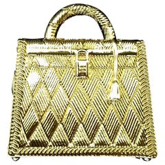Hermès Curiosity Kelly Bag Pendant Charm Permabrass Metal