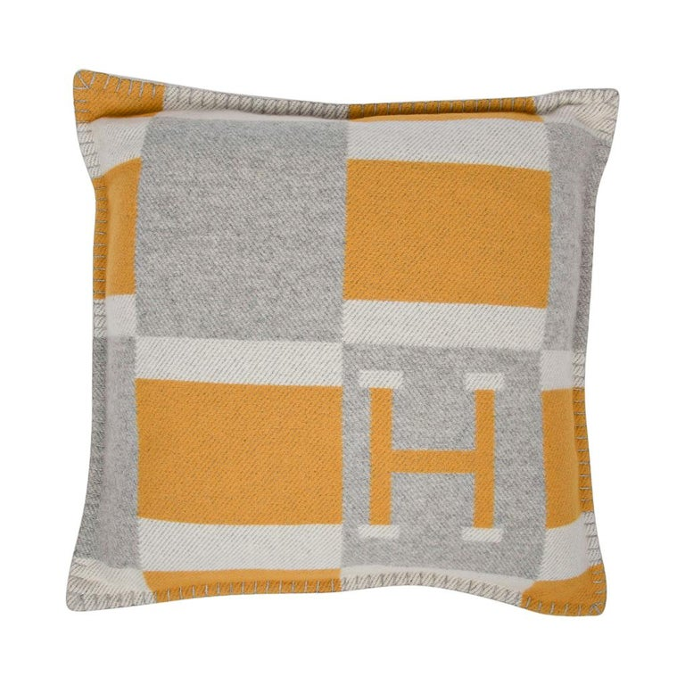 Guaranteed authentic Hermes small model Avalon Bayadere pillow features the iconic H in Jaune, Gris and Ecru. The removable cover is created from 90% Wool and 10% cashmere and has whip stitch edges. New or Pristine Store Fresh Condition.   Comes