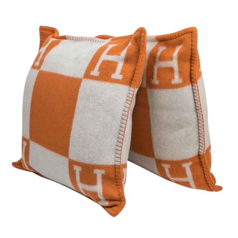 Guaranteed authentic Hermes classic set of two PM Avalon I signature H pillow featured in Orange. The removable cover is created from 85% Wool and 15% cashmere and has whip stitch edges. New or Pristine Store Fresh Condition.   Comes with