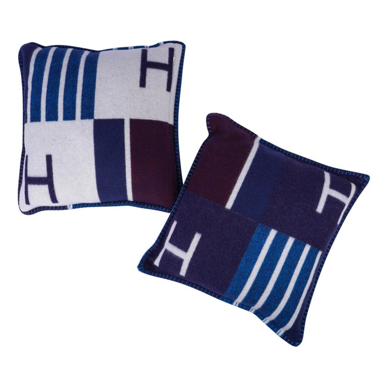 Guaranteed authentic Hermes Vibration throw pillow with signature H  featured in Blue Marine with Purple accent. The removable cover is created from 90% Wool and 10% cashmere and has whip stitch edges. New or Pristine Store Fresh Condition.  final