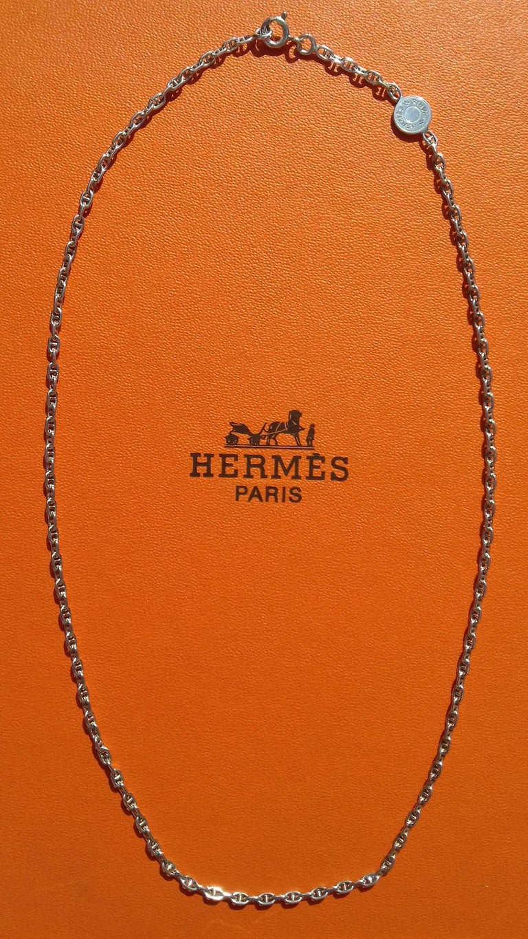 Rare and Beautiful Authentic Hermès Necklace  Pattern: Mini Chaine d'Ancre  Adorned with a small Clou de Selle in Silver  Super cute ! The meshes are small, the chain is very delicate, very fine  Made of Sterling Silver