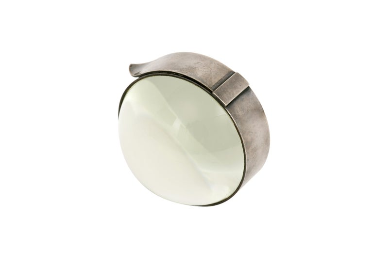 Vintage Hermes Paris magnifying glass desk accessory with domed lens ensconced in a silver frame with a belt design. We've left the oxidation and patina untouched and simply added a coat of wax to enhance its character. Very nice condition, embossed