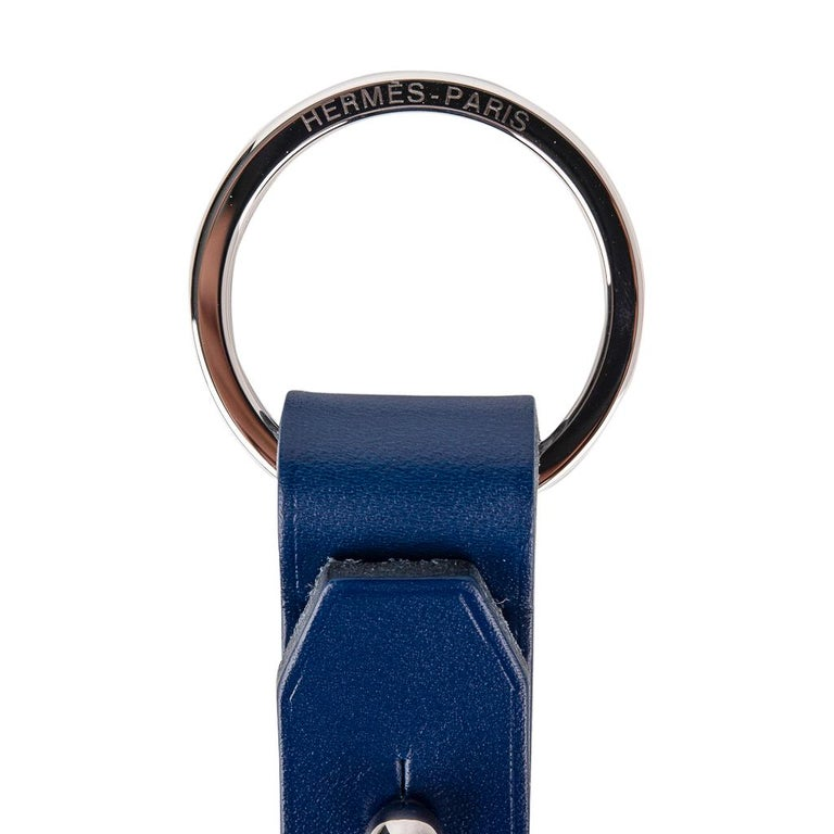 Guaranteed authentic Hermes Double Jeu Voiturier valet Key Ring in Bleu Saphir ( Blue Sapphire) Vache Hunter leather. Can be opened to separate key rings. Hermes Paris embossed on both rings. Comes with signature Hermes box.  New or Store Fresh