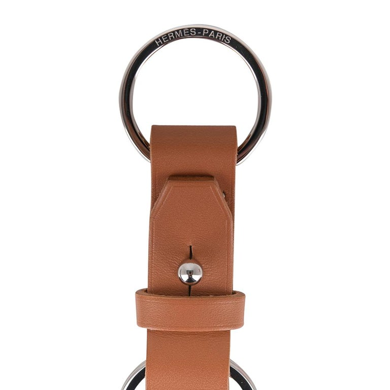 Guaranteed authentic Hermes Double Jeu Voiturier valet Key Ring featured in Gold Vache Hunter leather. Can be opened to separate key rings. Hermes Paris embossed on both rings. Comes with signature Hermes box.  New or Store Fresh Condition.    final