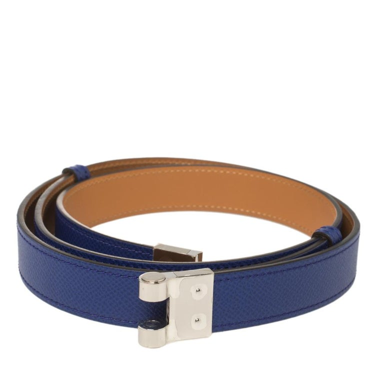 Accessorise like a style icon using this amazing Charniere belt by Hermes. The piece is crafted from Epsom leather in an electric blue hue and completed with a palladium-finished metal push-lock that seamlessly fastens it.  Includes: Original
