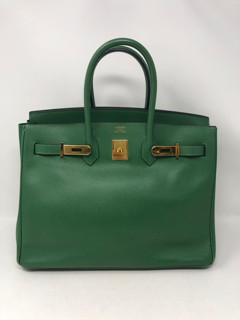 Hermes Birkin 35 in Emerald Green color. It is a beautiful deep green that is the most wanted color for the Season. Gold hardware and courchevel leather. Vintage Birkin in great condition. Light wear only on corners. Barely noticeable and leather in