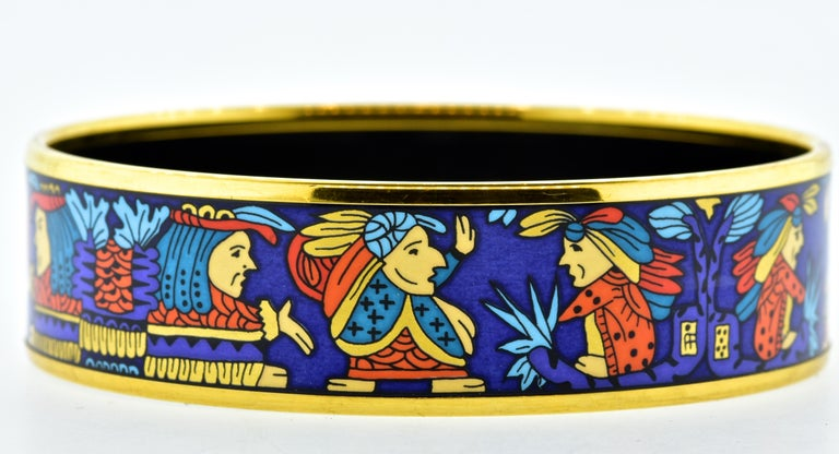 Hermes Paris enamel bangle bracelet, size large.  Multi color enamel, this wide statement is .75 inches wide and had an interior diameter of 2.75 inches which is medium to wide wrist.  This vintage Hermes Paris piece is in excellent condition.  It