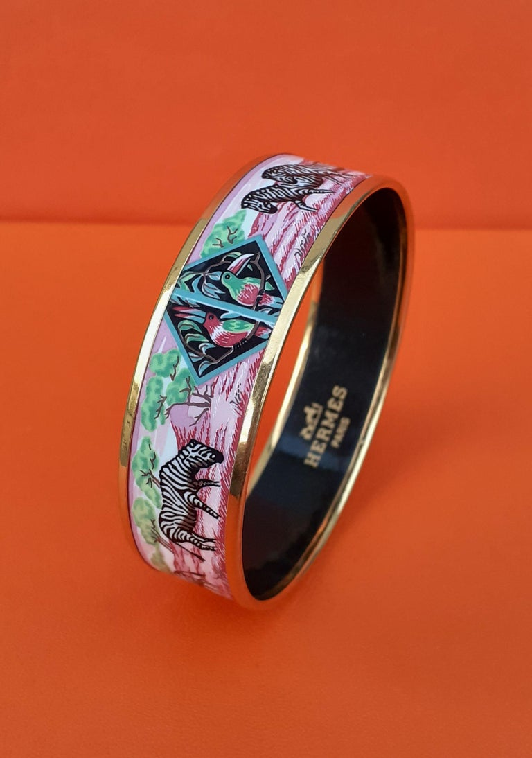 Super Rare and Beautiful Authentic Hermès Bracelet  Pattern: Zebras and Toucans  From the scarf called