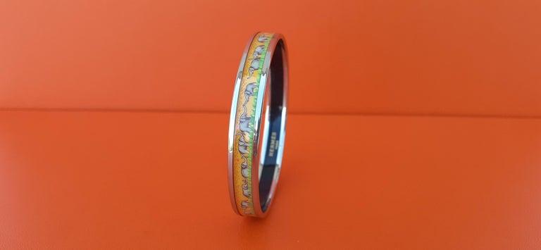 Hermès Enamel Printed Bracelet Elephants Grazing Yellow Phw Narrow Size 65 In Good Condition For Sale In ., FR