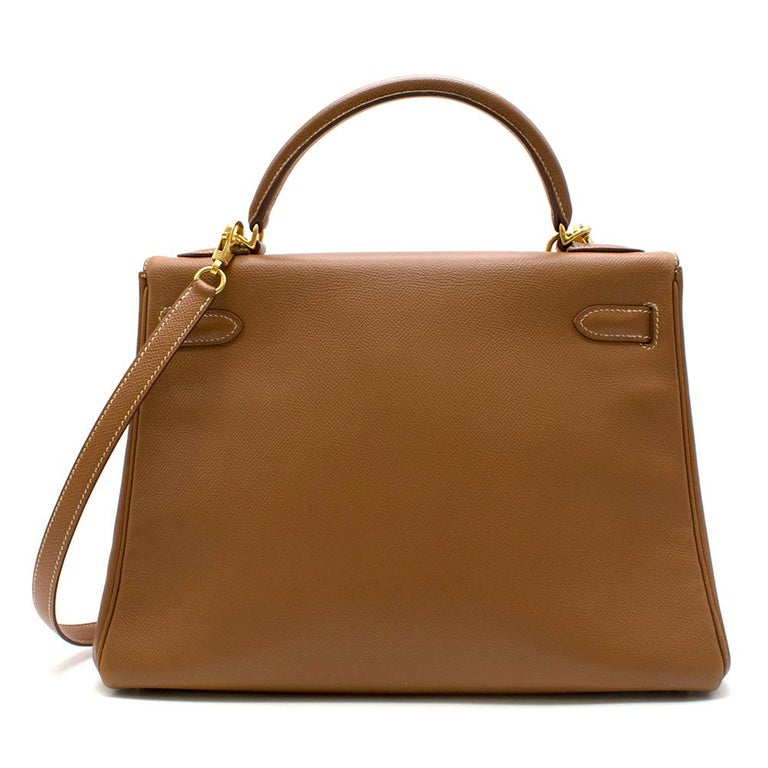 Hermes Kelly Retourne 32 - Gold Epsom Leather with white contrast stitching, Gold hardware. Comes with Shoulder strap, clochette, lock & keys. Hermes 2000