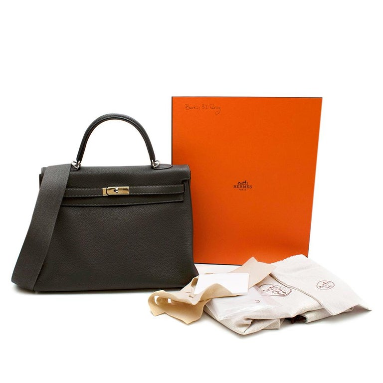 Hermes Etain Clemence Leather Kelly 35 PHW  Arguably the holy grail of bags the Hermes Kelly is absolutely iconic.  -Made of soft textured Clemence taurillion leather   -Iconic fastening to the front  -Palladium hardware   -etain colour