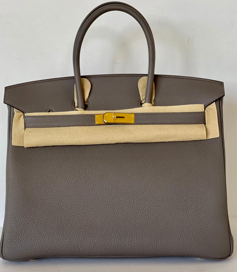 Birkin 35 Etain, such a great neutral grey that goes with just about everything Togo leather, durable and scratch resistant Gold Hardware Tonal Stitching Inside zipper pocket and slip pocket Collection Y Brand new store fresh Ready for